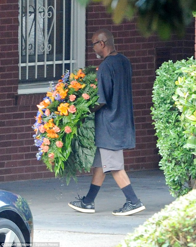 Grand: By the looks of the flowers being brought in, Bobbi's funeral will be a grand affair