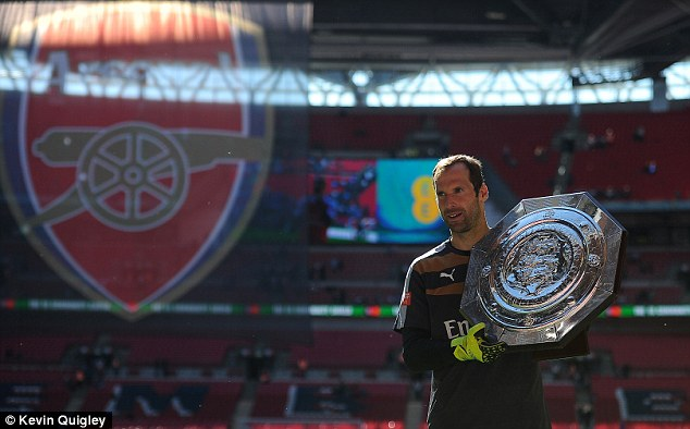 Cech poses with the spoils, the Community Shield, of his official debut against his former club