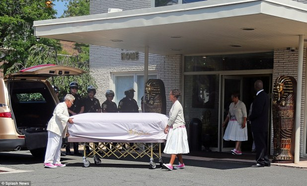 Bobbi Kristina Brown's casket pictured being brought out of the funeral home and put into the hearse for her burial on Monday