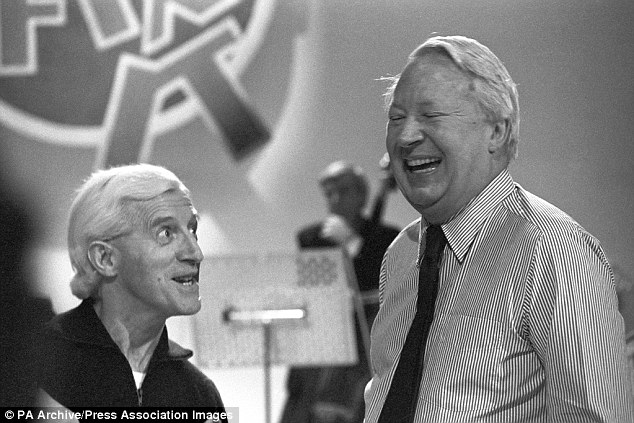 TV personality: With Jimmy Savile, since exposed as a prolific paedophile, on Jim'll Fix It in 1980. Heath conducted an orchestra on an episode of the show