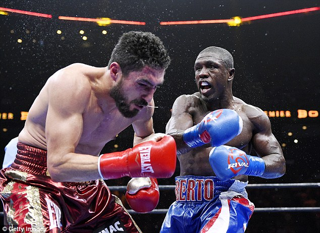 Andre Berto lands a punch against Josesito Lopez during their 12 round welterweight bout in California