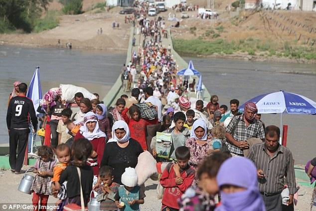 Escape: ISIS asaltaron el distrito Sinjar (en la foto en agosto) en el norte de Irak el año pasado y capturó cientos de mujeres pertenecientes a la comunidad yazidi