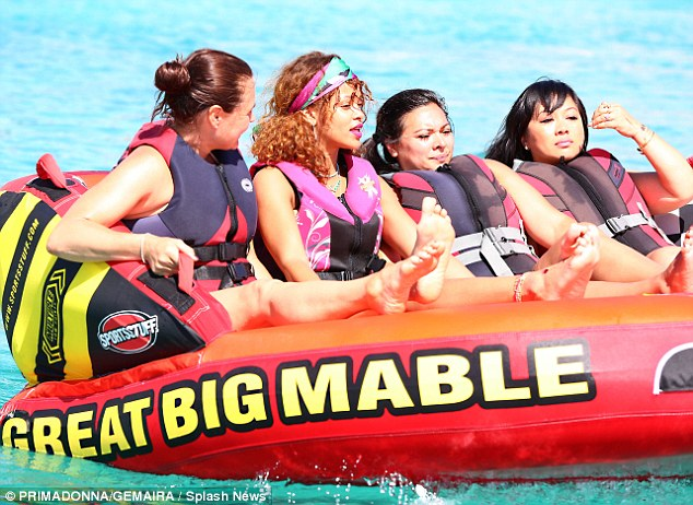 Girls only: Rihanna, 27, who was clad in a bright pink life jacket, rode a vessel with three of her girlfriends, and Lewis with one male companion