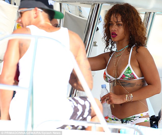 Fueling romance rumours: Rihanna and Lewis were also seen hanging out together on board a luxury boat