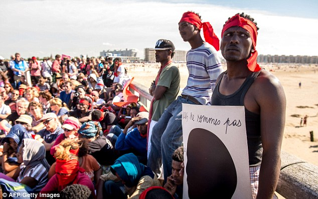 Arguments: Authorities in Calais have threatened to start letting the migrants through if they don't get help from David Cameron and the UK