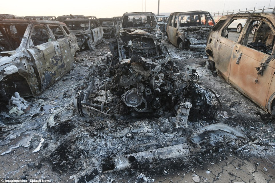 Mangled: This car was turned into a twisted lump of metal from the force of the explosion in the Binhai New Area in Tianjin, China