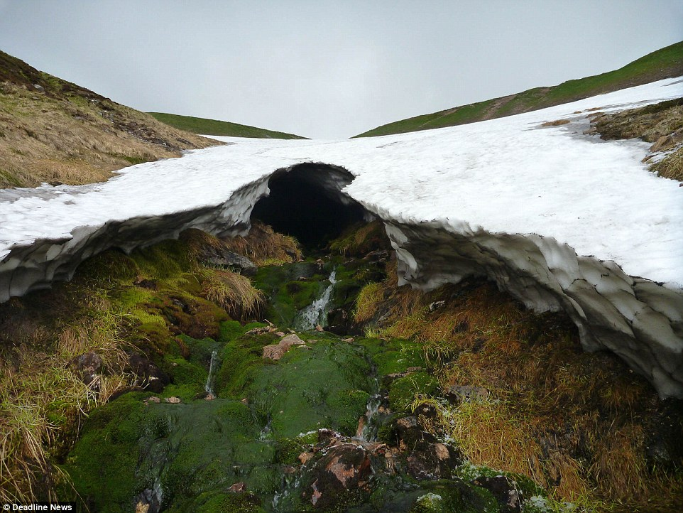 A cold summer in Scotland has led to this incredible natural phenomena with remaining ice and snow forming a network of icy tunnels and caves clinging to the edge of mountains