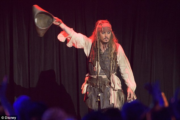 Lovable rogue: Johnny Depp dressed up as his famous - or infamous - character from Pirates Of The Caribbean as he took to the stage at Disney's D23 Expo in Anaheim, California on Saturday