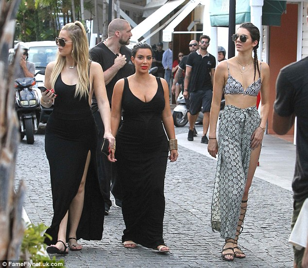 Here come the girls: The E! TV stars certainly drew attention as they walked the cobbled streets