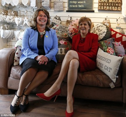 Victim: Married Edinburgh MP Michelle Thomson, pictured with Scottish National Party leader Nicola Sturgeon,  said her identity was 'harvested' by hackers who falsely suggested she was  an  Ashley Madison member