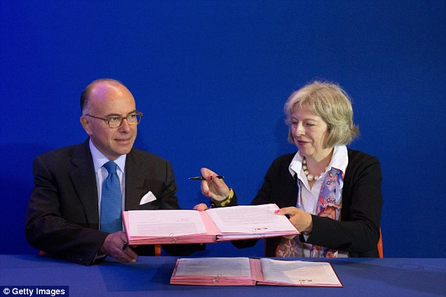 Deal: The Home Secretary signed a deal with Bernard Cazeneuve to supposedly strengthen Britain's role in tackling the migration crisis amid concerns the French government is struggling to cope
