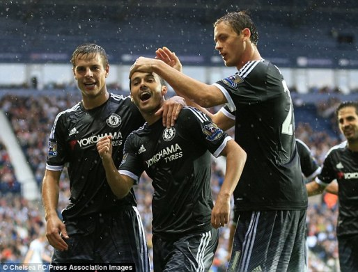 Pedro (centre) celebrates with his Chelsea team-mates after scoring on his debut against West Brom