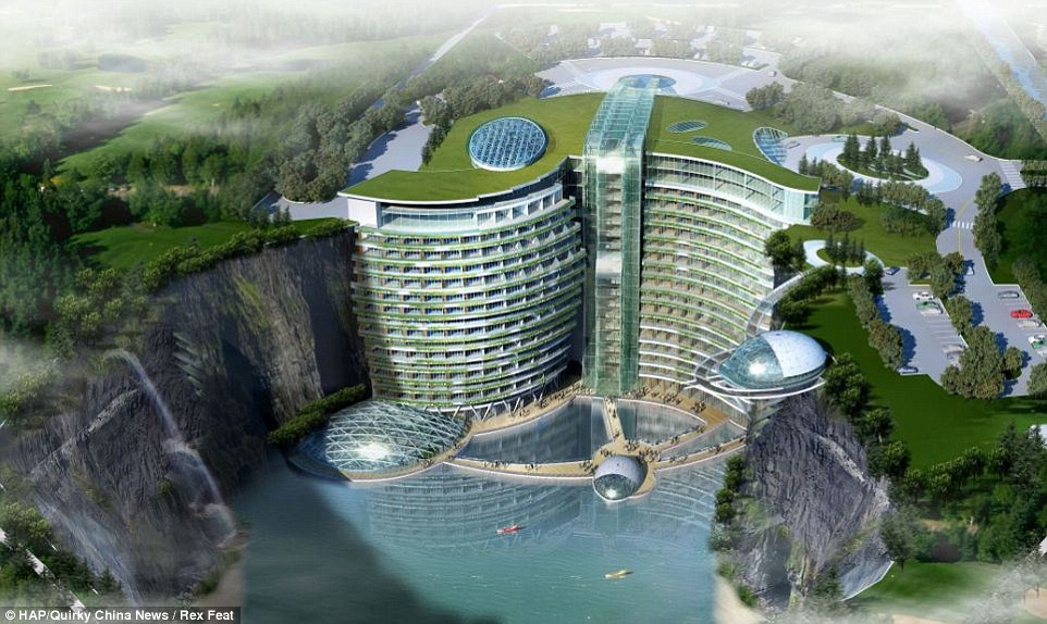 An artist's view of what the finished cave hotel will look like. The 5-star underground resort is being built inside a 100-foot deep, water-filled abandoned quarry in China at the base of the Tianmenshan Mountain in the Songjiang District