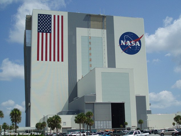 An investigation by Daily Mail Online has revealed 16 current and former staff members working for NASA purchased child pornography from Eastern Europe, but avoided prosecution and could still be working for the space agency. Pictured is the vehicle assembly building at the JFK Space Center at Cape Canaveral, Florida