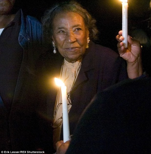 Civil Rights veteran foot soldier Amelia Boynton Robinson pictured participating in a candle light vigil at the foot of the Edmund Pettus Bridge before the election returned in Selma, Alabama, in Nov 2008