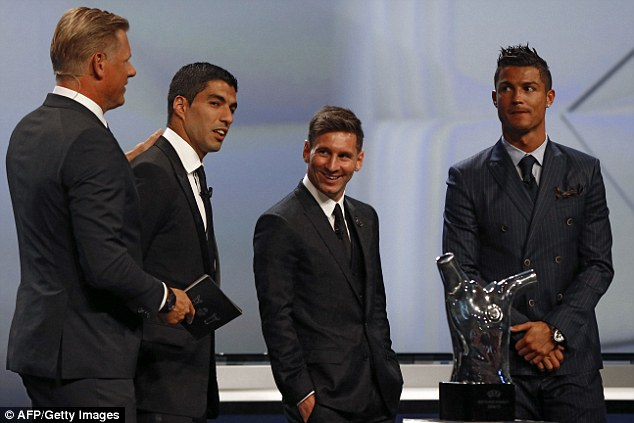 Messi (second right) and Ronaldo (right) look on as Peter Schmeichel (left) chats to Luis Suarez