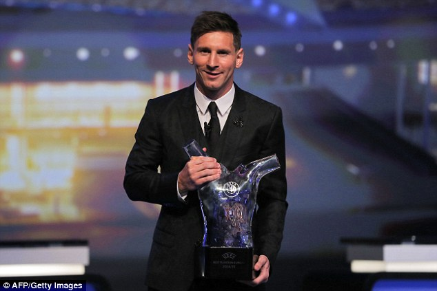 Messi poses for pictures with the trophy after being announced as UEFA's Best Player in Europe
