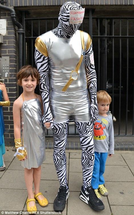 Notting Hill Carnival 2015 revellers ignore downpour