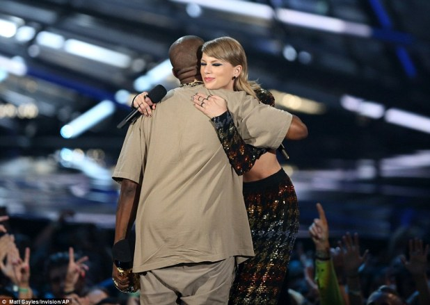 Kanye West and Taylor Swift embrace after she presented him with the Video Vanguard Award