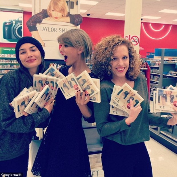 When Taylor's latest Album, 1989, was released, she posted this photo of herself with friends Lily Aldridge (left) and Abigail (right), who purchased handfuls of the CDs from Target