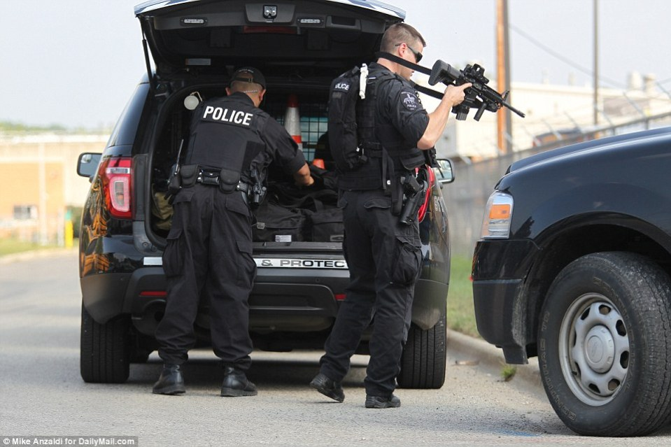 Police with heavy weapons were seen getting ready to flush out the suspects, who have not been seen since the killing