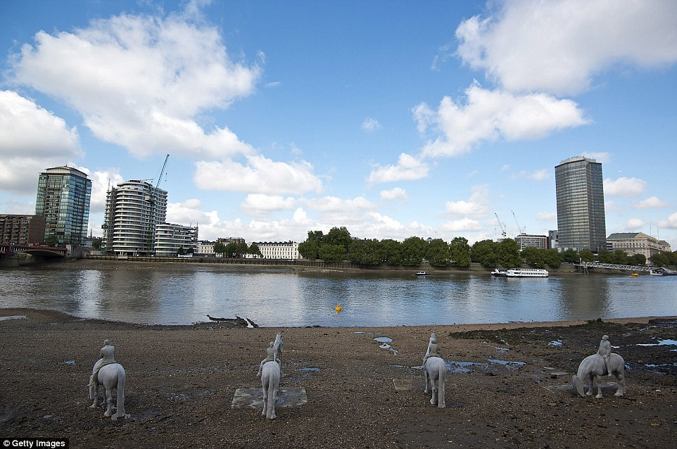 Eye-catching sight: 'The Rising Tide' is pictured being installed on the bank of the River Thames, at Nine Elms on the South Bank