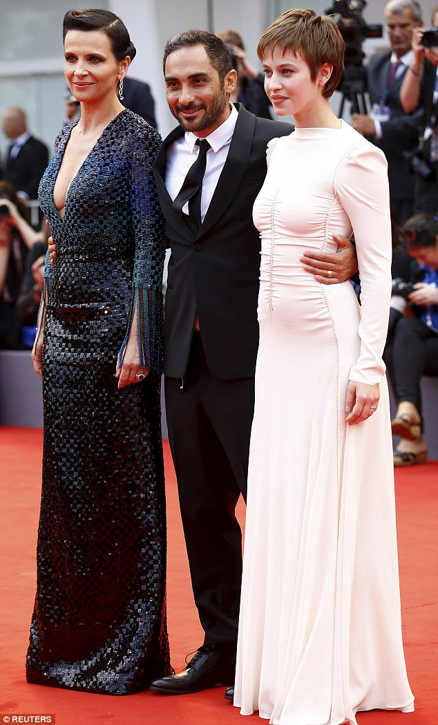 Altogether: The French actresses pose with director Piero Messina during the red carpet event for the movie L'Attesa, or in English 'The Wait'
