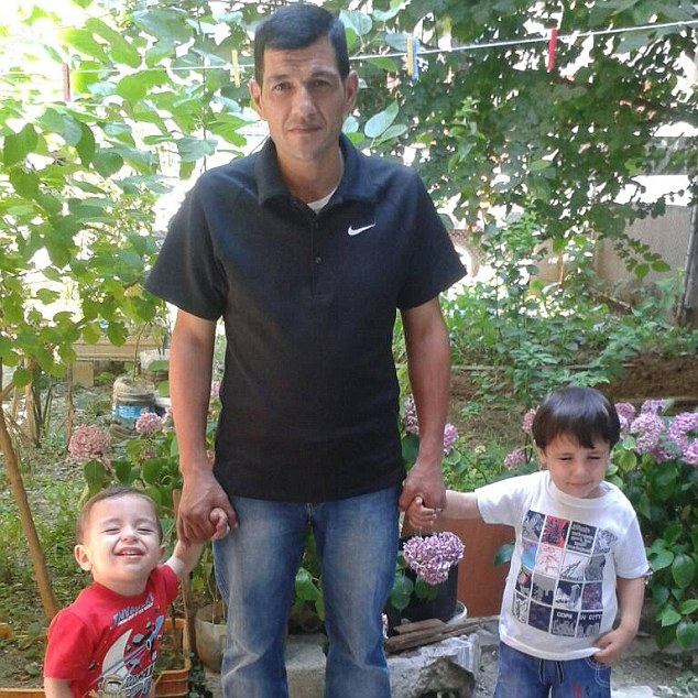 Family: Adbullah Kurdi pictured with his sons Aylan (left) and Galip (right) who died when their boat capsized