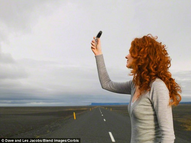 Searching for a mobile phone signal can be a frustrating necessity for many people who struggle to get decent reception in their own homes. However, there are a handful of simple tricks that can improve mobile signal. A stock image of a woman searching for mobile reception is pictured