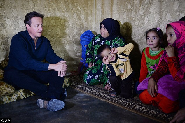 Warning: As British Prime Minister David Cameron visited Syrian refugees in camps in Lebanon this week,  a minister warned two in every 100 Syrian migrants smuggled into Europe are ISIS-trained fanatics