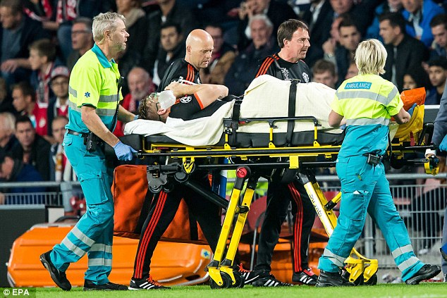Manchester United's Shaw is taken off on a stretcher following what looked like a horrific injury on Tuesday