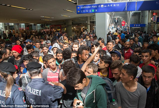 Claims: The forger told MailOnline that 'everyone wants to be Syrian now – because now everyone welcomes Syrians. There are Palestinians, Egyptians, Iraqis, people from all over the Arab world pretending to be Syrian so they can have a new life in Europe'. Pictured are migrants at Salzburg station, Austria on Tuesday
