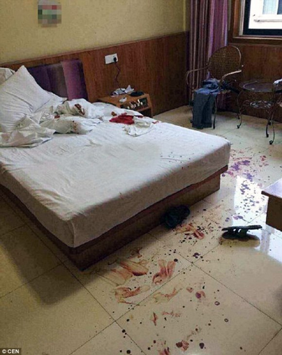 Staff found the bed and floor of the room was splattered with blood (above) with clothes and shoes left around
