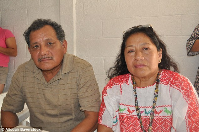 Heartbroken: Maria Rodriguez (right) and Atanacio Molina's (left) eldest son Josué Molina disappeared last year when three armed men kidnapped him