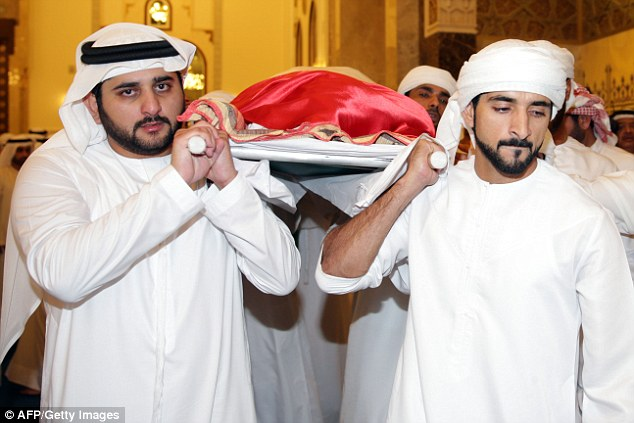 Sheikh Maktoum bin Mohammed al-Maktoum (left) and Sheikh Hamdan bin Mohammed al-Maktoum (right) carry the body of their late brother