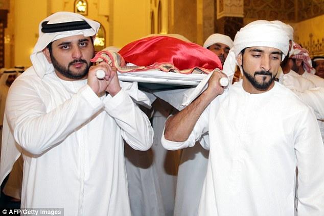 Sheikh Maktoum bin Mohammed al-Maktoum (left) andSheikh Hamdan bin Mohammed al-Maktoum (right) carry the body of their late brother