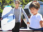 Orlando Bloom took his son Flynn out to the surf shop in Malibu as he picked out a new longboard, on Saturday, September 19, 2015. X17online.com