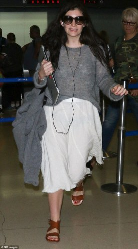 Covering up: Lorde hid her 'weeping' eye infection behind over-sized sunglasses as she arrived into LAX Airport on Saturday