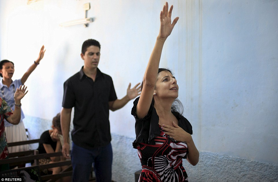 Evangelicals pray during a service at a private house in Holguin, Cuba, following Pope Francis' Mass in Havana's Revolution Square on Sunday