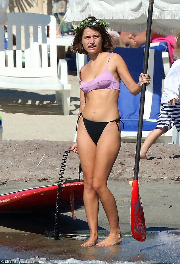 The apple doesn't fall far from the tree: Wearing a pink and black bikini as she enjoyed the warm weather, she was the spitting image of her former INXS frontman father