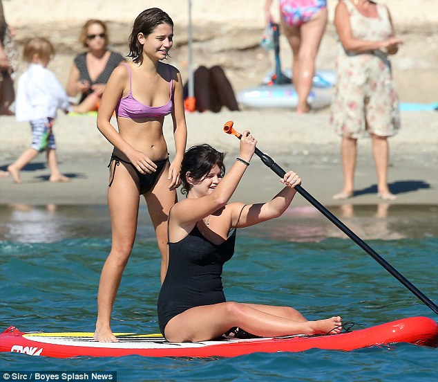 The wetter the better: Later she joined Pixie on the surfboard and enjoyed being powered across the surface of the water, while laughing and joking