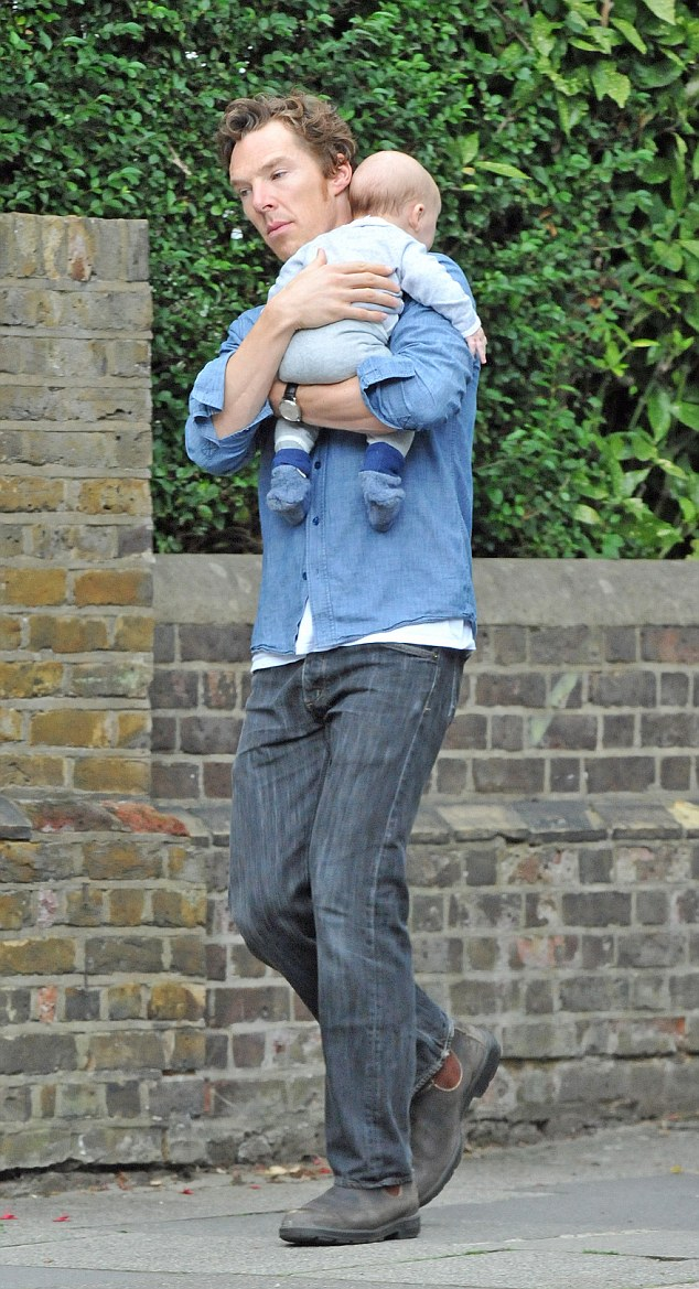 Doting dad: Cumberbatch, who is currently starring in a critically-acclaimed production of Hamlet, was spotted out and about with his new baby in London
