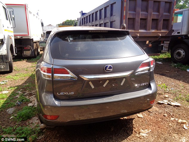 Scam: Detectives tracing this Lexus stolen from London ended up locating it in Uganda alongside a fleet of cars worth more than £1 million