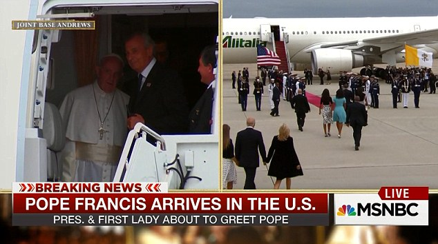 Keeping a lookout: The Pope had a just over two-minute wait at the open door of his plane while the president arrived. The delay was said to be to allow reporters traveling with him to leave by the back stairs