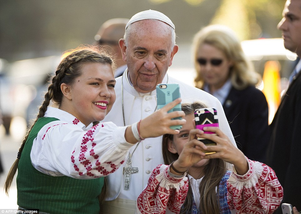 Pope Francis takes a photo with children, whose parents work at the Lithuanian Embassy, outside the Apostolic Nunciature