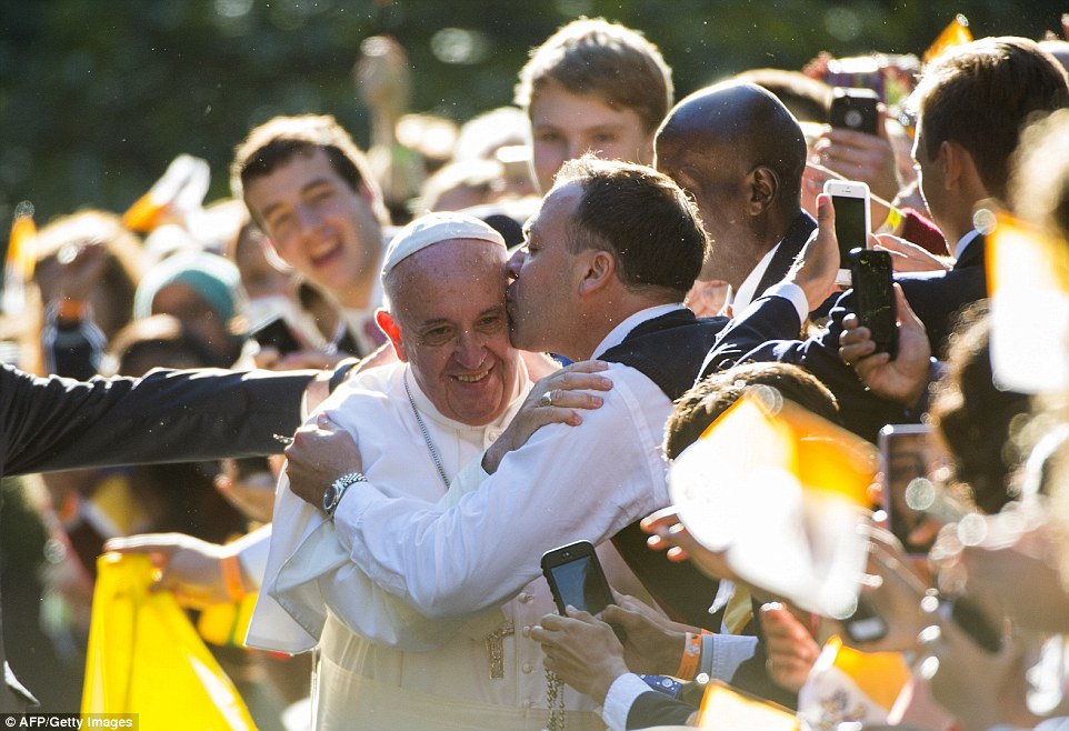 Pope Francis takereceives a kiss, outside the Apostolic Nunciature on Wednesday