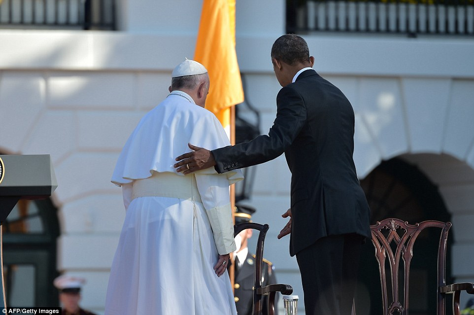 Obama offers the pontiff a seat before giving his much-anticipated speech to welcome him to America