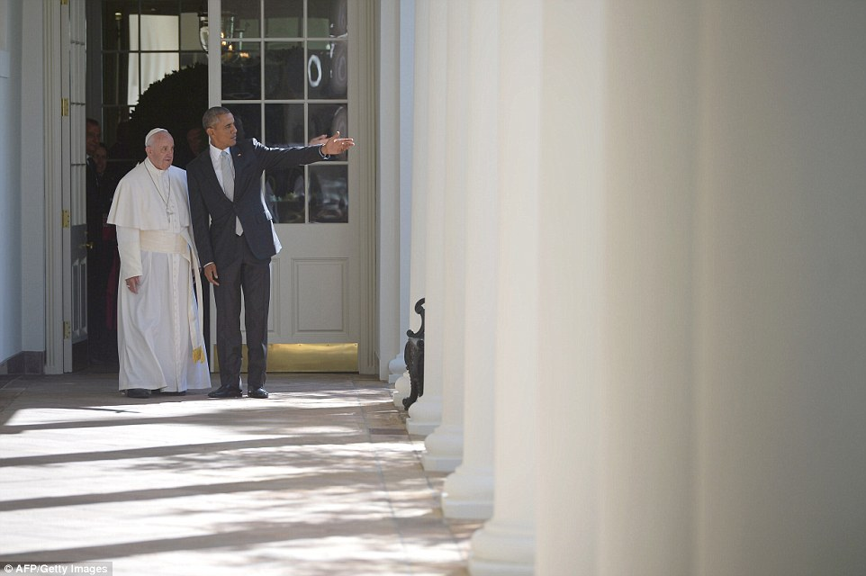 The pope receives a personal tour of the Oval Office from President Obama after giving a speech to thousands