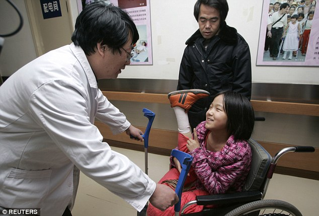 At 11, the girl talks to a doctor at China Rehabilitation Center in Beijing in 2007 after receiving her new legs