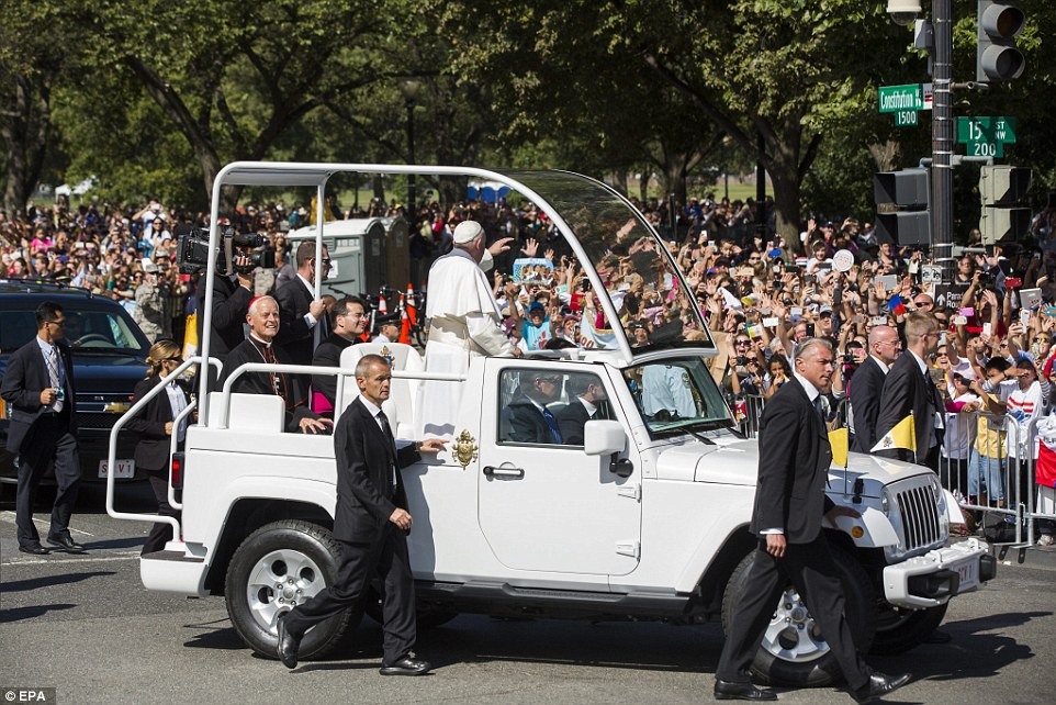 After Pope Francis' private meeting with the president, he went outside in his pope-mobile to greet the tens of thousands of adoring fans who had been waiting since before dawn to catch a glimpse of the pontiff